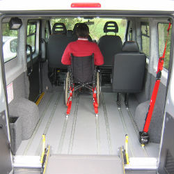 accommodate a wheelchair and its occupant